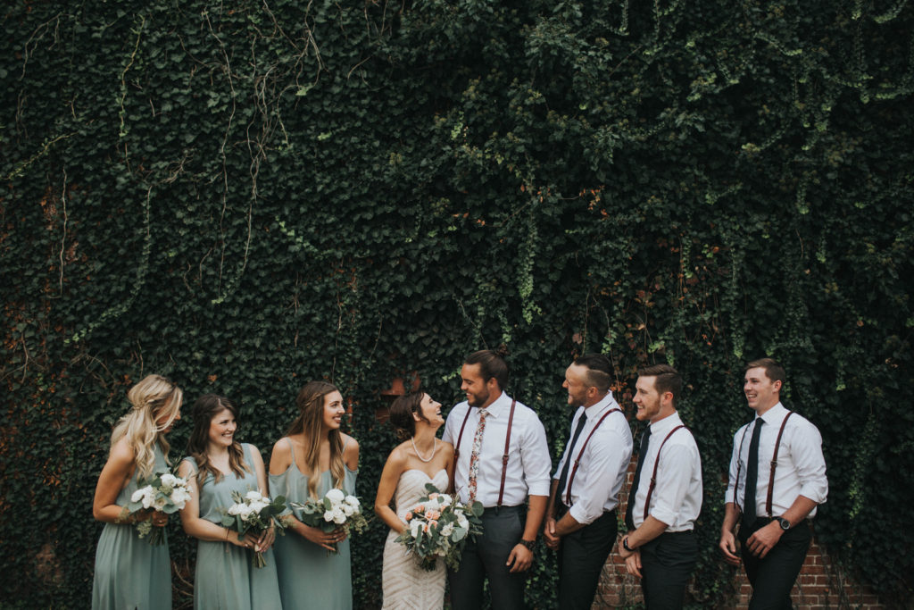 Wedding party at the Lavington contortion arkansas, wedding photography by the johnsons photo, sage green bridesmaids dresses, floral groomsmen ties